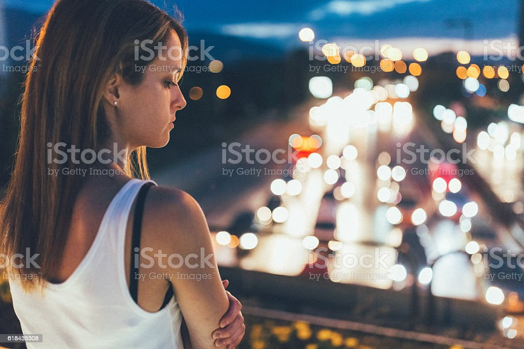 Depressed woman in the city stock photo