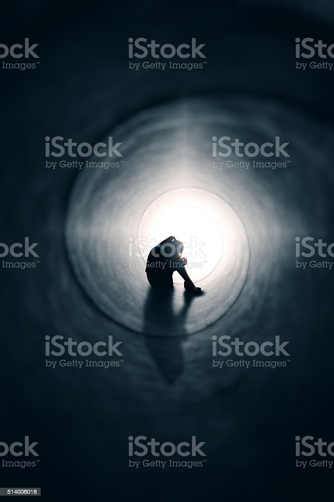 Depressed Woman In Tunnel Of Light stock photo