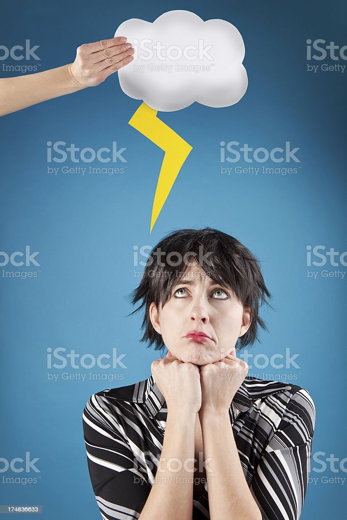 Depressed Woman Looking Up at Thunderstorn Cloud Over Head stock photo
