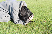 Depressed woman on the green field