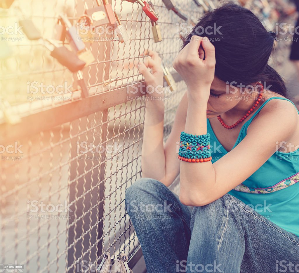 Depressed woman outside stock photo