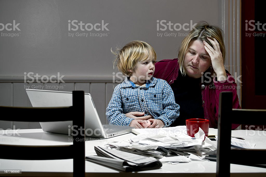 Depressed woman overwhelmed with financial issues, debt, bankruptcy. stock photo