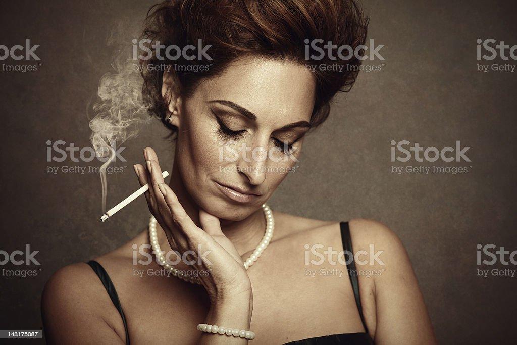 depressed woman smoking stock photo