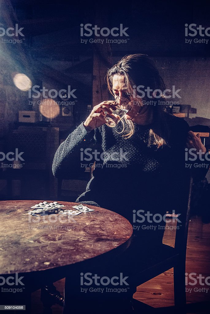Depressed Woman Taking Pills at Home stock photo