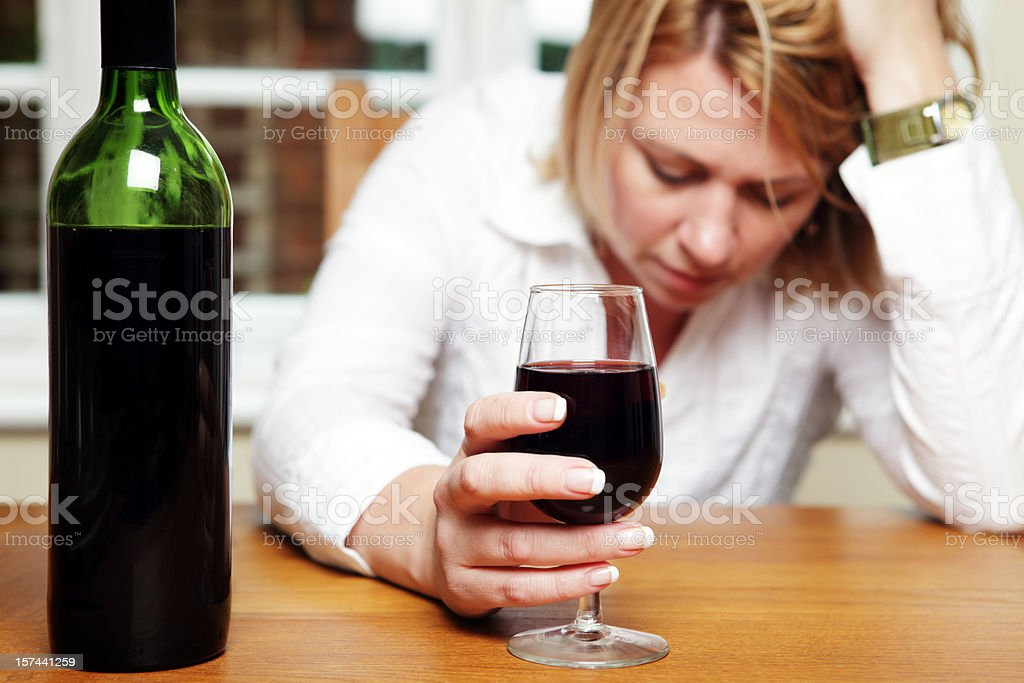 Depressed Woman with Alcohol royalty-free stock photo