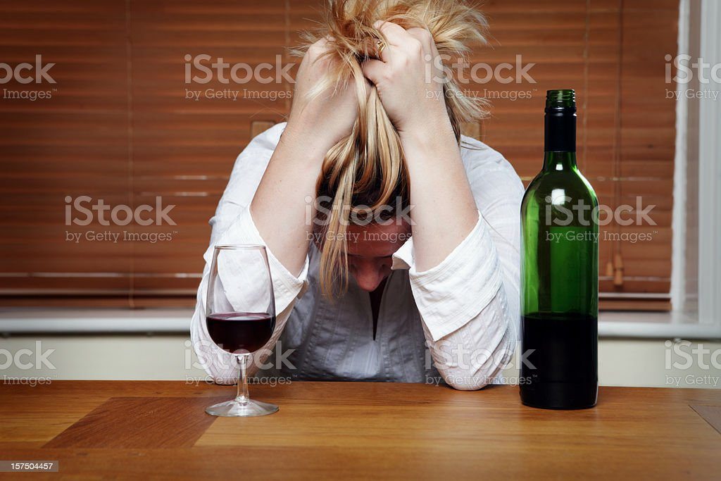 Depressed Woman with Red Wine royalty-free stock photo