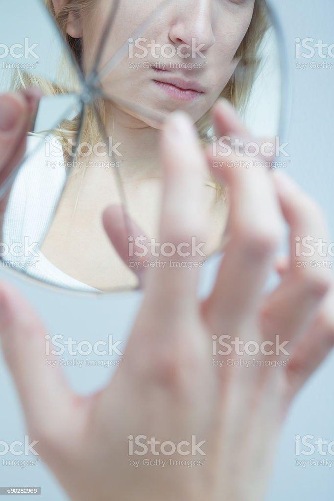 Depressed woman with schizophrenia stock photo