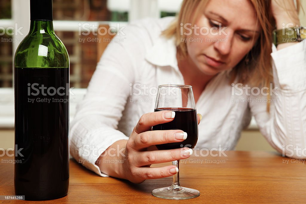 Depressed Woman with Wine royalty-free stock photo