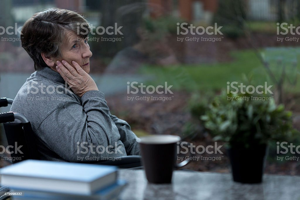 Depressed women in a wheelchair stock photo