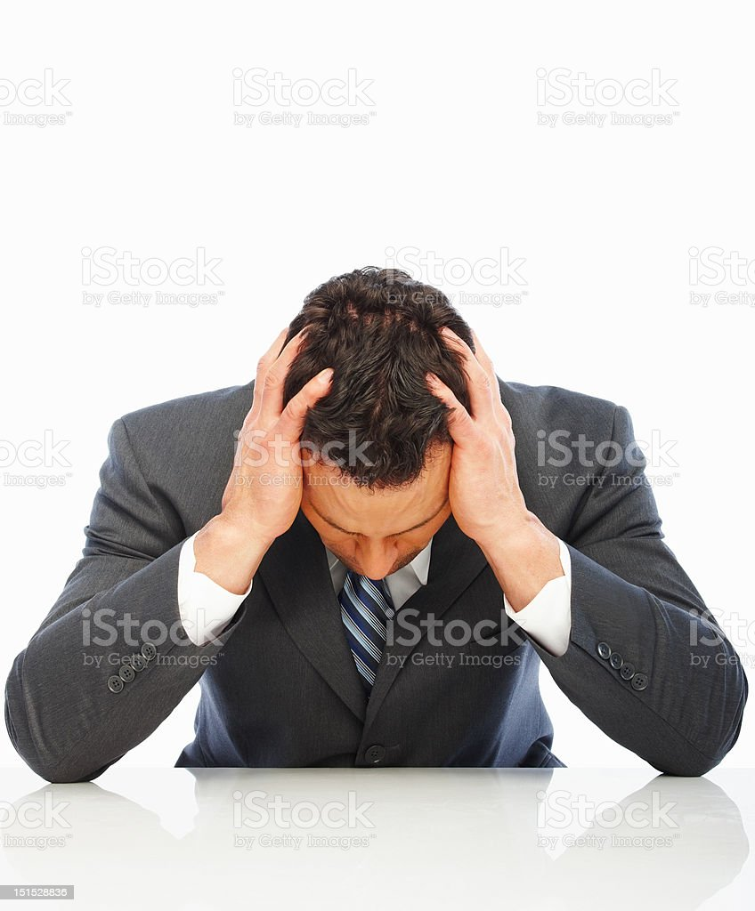 Depressed young businessman isolated on white royalty-free stock photo