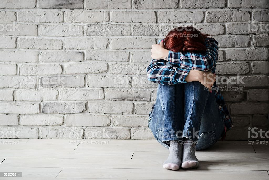 Depressed young crying woman - victim stock photo