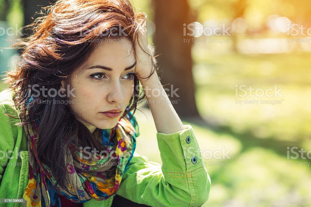 Depressed young girl crying stock photo