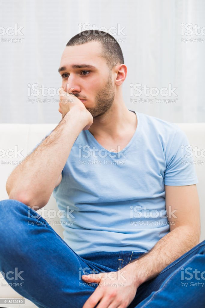 Depressed young man stock photo