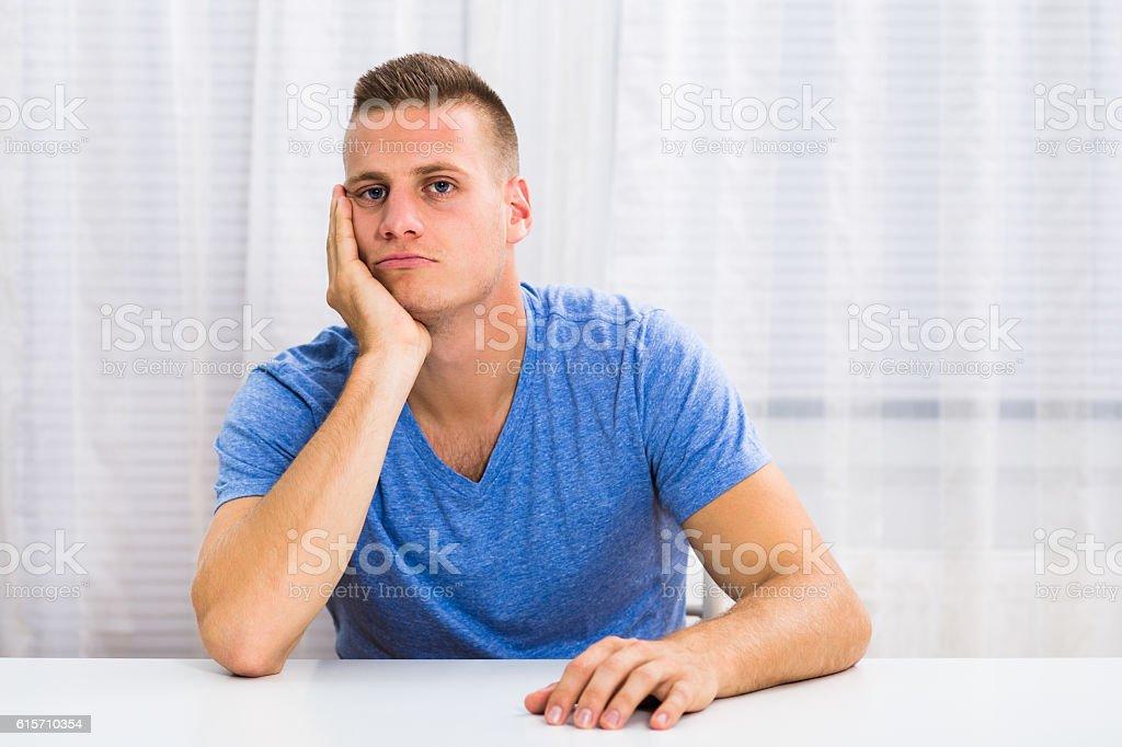 Depressed young man thinking stock photo