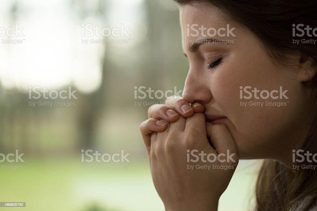 Depressed young woman crying stock photo