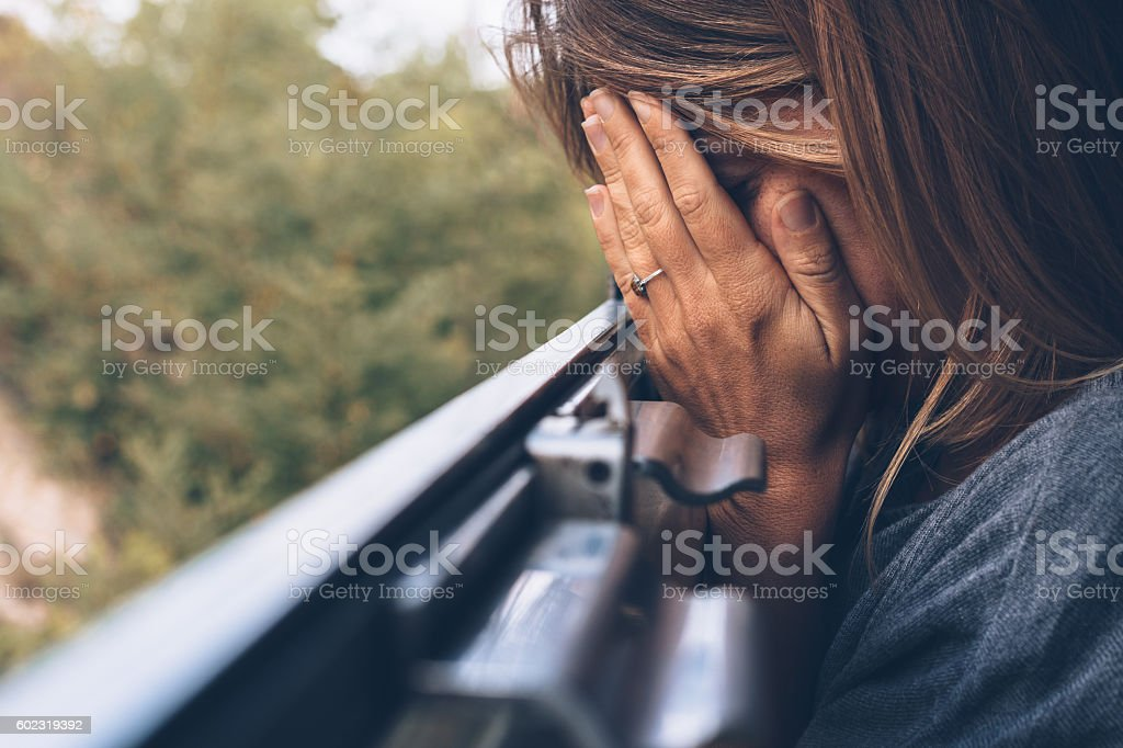 Depressed young woman in the train stock photo