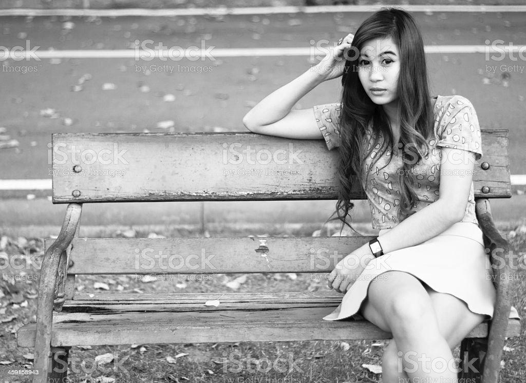 Depressed young woman sitting alone royalty-free stock photo