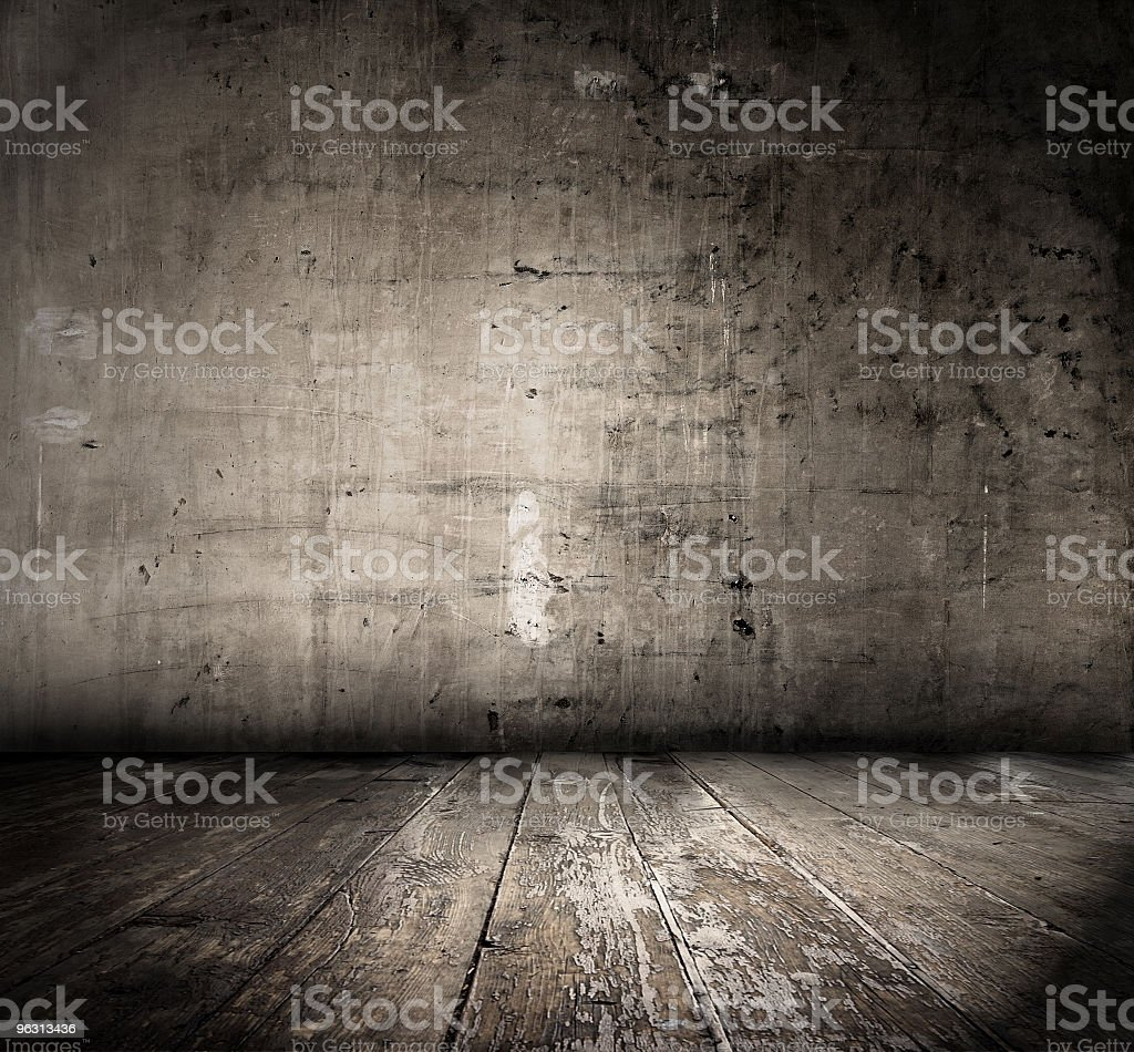 A depressing grunge room with wooden floorboards royalty-free stock photo
