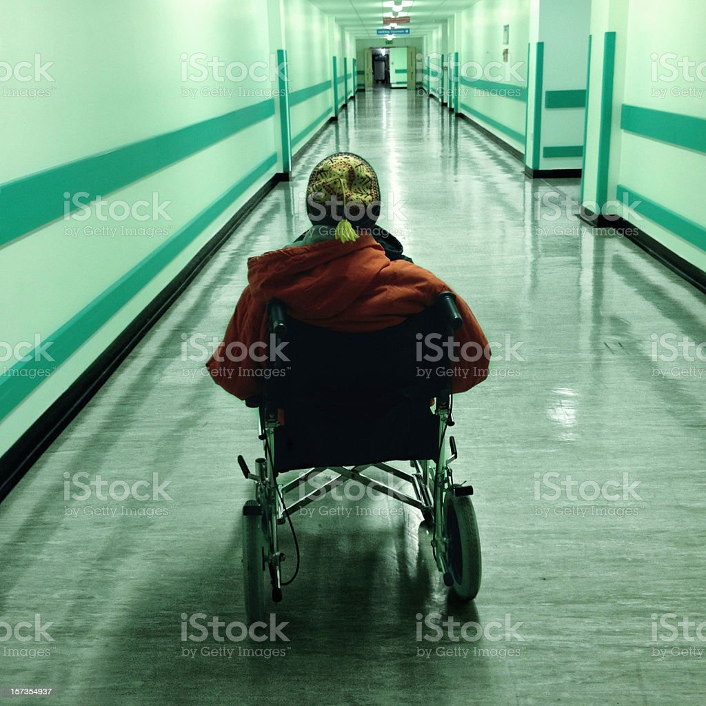 Depressing Hospital Corridor with Disabled Patient stock photo