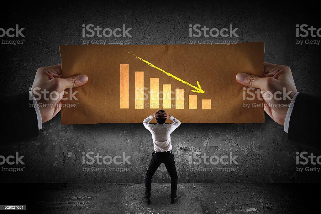 depression businessman watching falling graph stock photo
