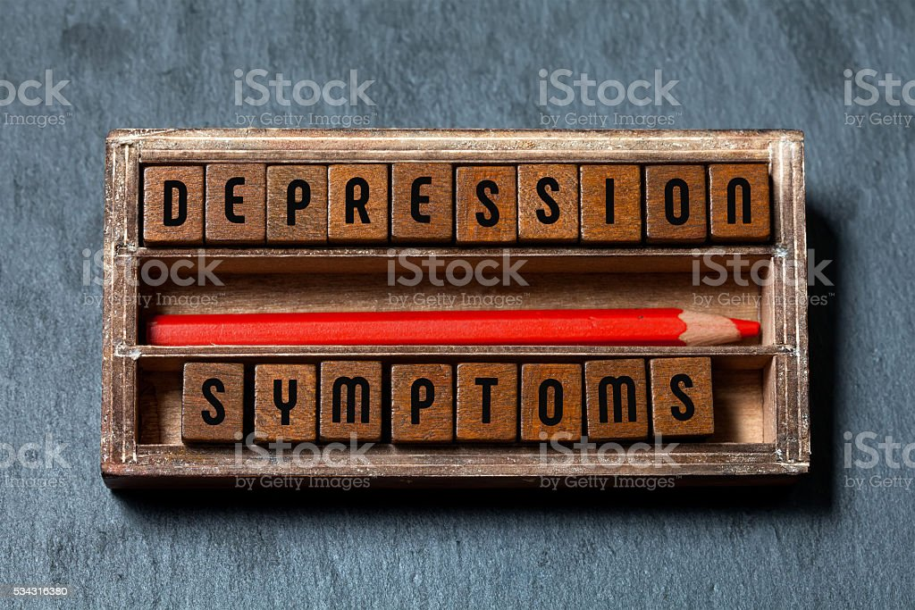 Depression symptoms conceptual image. Vintage box with textured wooden blocks stock photo
