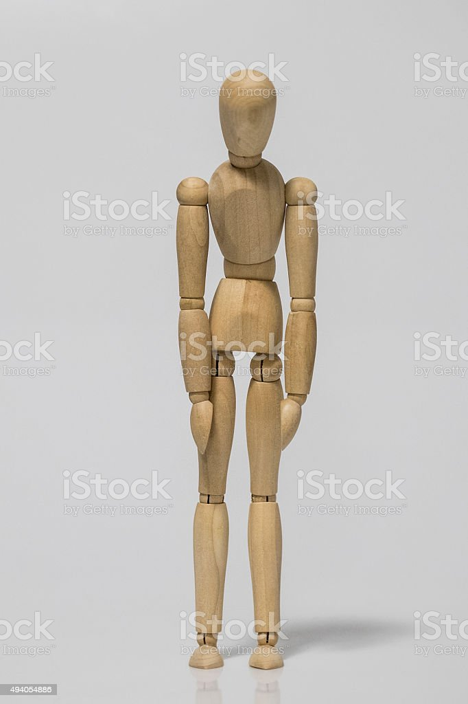 depressive or exhausted wooden mannequin crawling stock photo