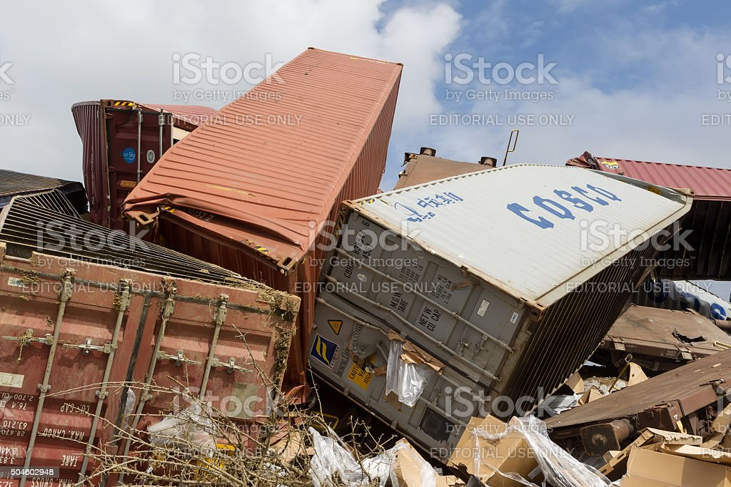 Derailed train coaches at the site of a train accident stock photo