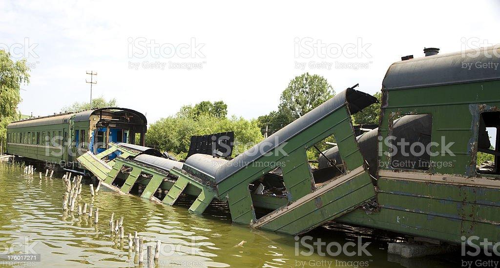 Derailed Train over a Russian lake. stock photo