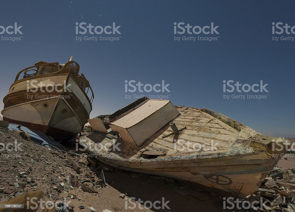 Derelict boats in the desert at night royalty-free stock photo