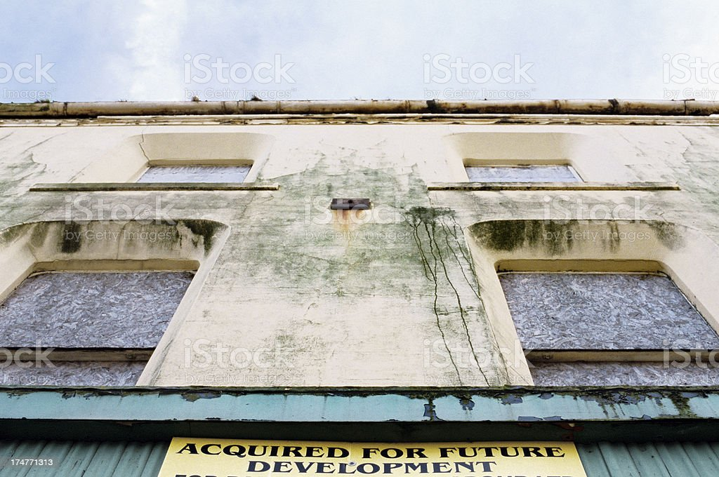 Derelict building ACQUIRED FOR FUTURE DEVELOPMENT stock photo