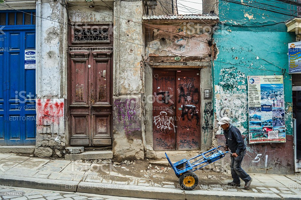 Derelict buildings and person on his own stock photo