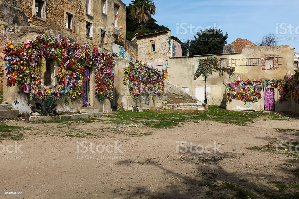 derelict buildings draped in colourful flowers stock photo