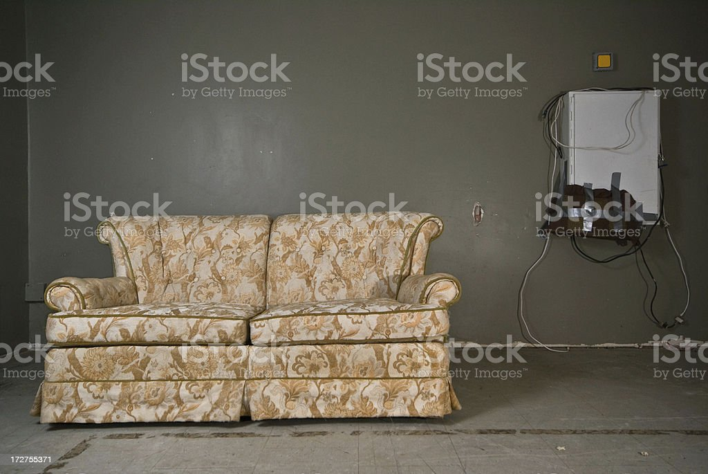derelict couch stock photo