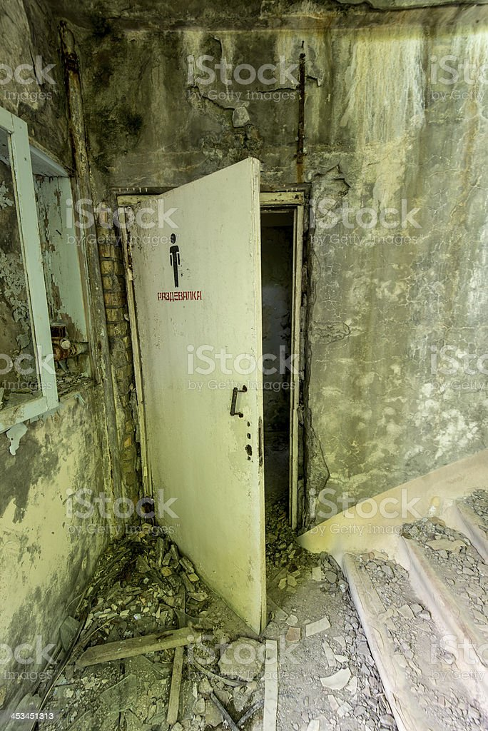 Derelict internal area of a building w loo door (Pripyat/Chernobyl) royalty-free stock photo