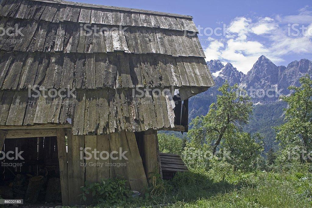 Derelict mountain hut stock photo
