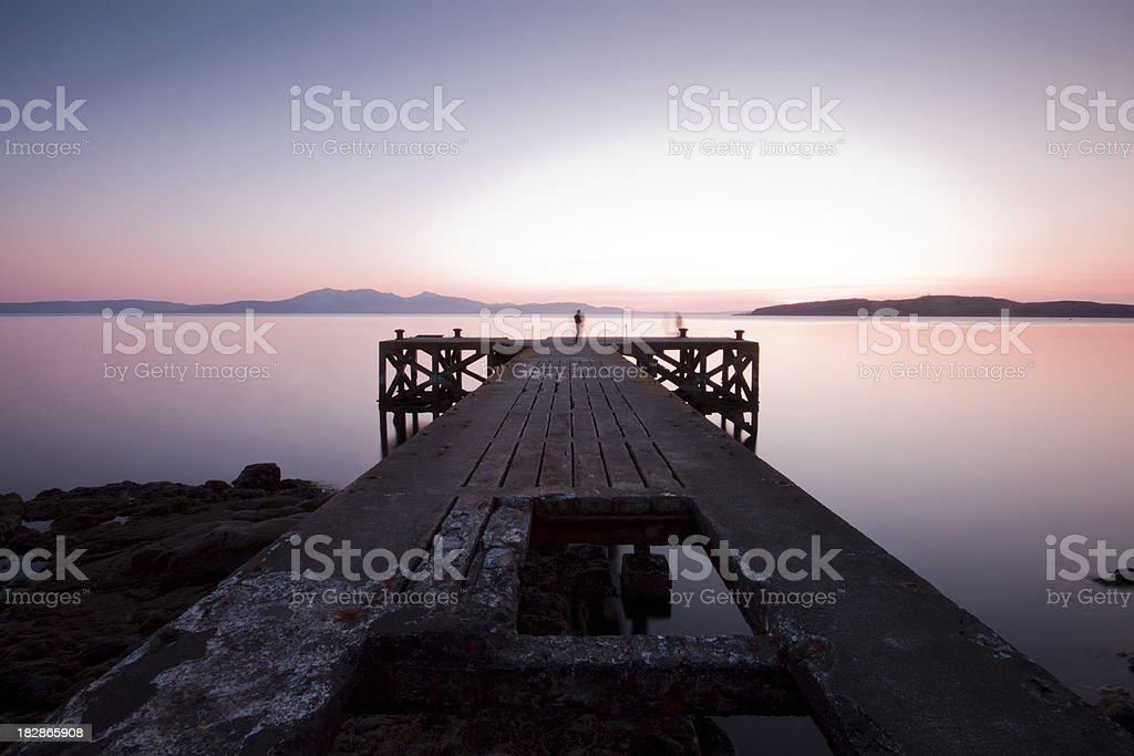 Derelict pier, Portencross at sunset. stock photo