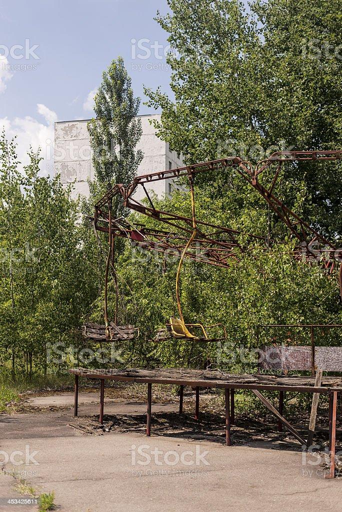 Derelict playgrouund ruins (Pripyat/Chernobyl) royalty-free stock photo