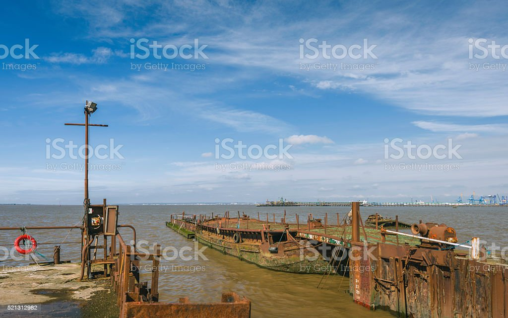 Derelict river boats and obsolete machinery in the Humber estuary. stock photo