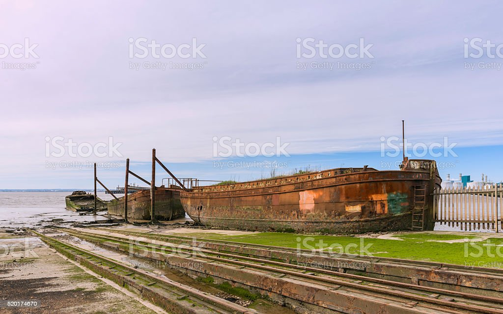 Derelict ships in disused ship yard, Paul, Yorkshire, UK. stock photo