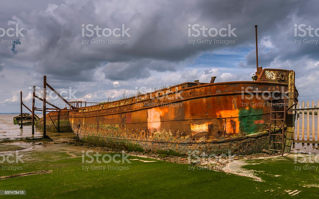 Derelict ships in disused ship yard, Paull, Yorkshire, UK. stock photo
