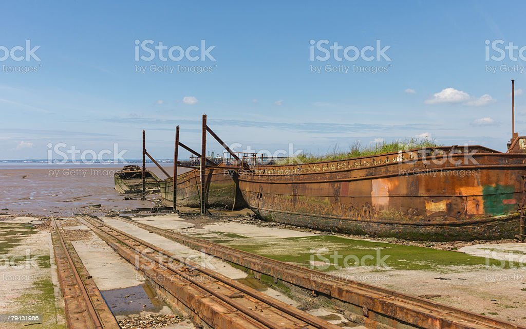 Derelict ships, winch, in disused ship yard, Paul, Yorkshire, UK. stock photo
