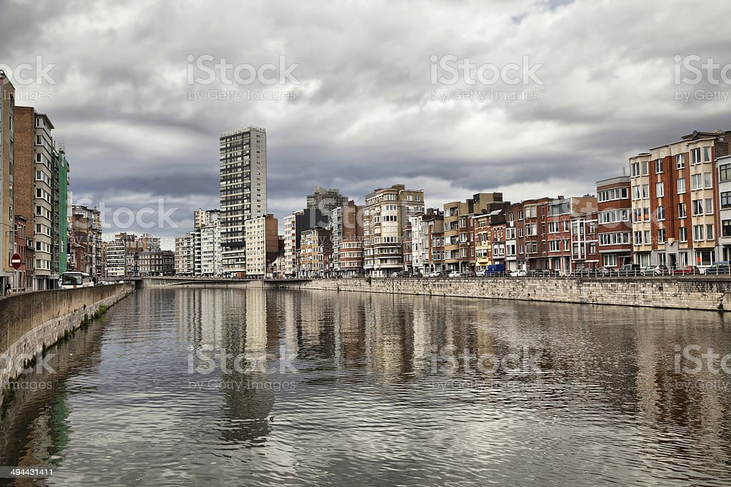 Derivation of river Meuse under cloudy sky in Liege stock photo