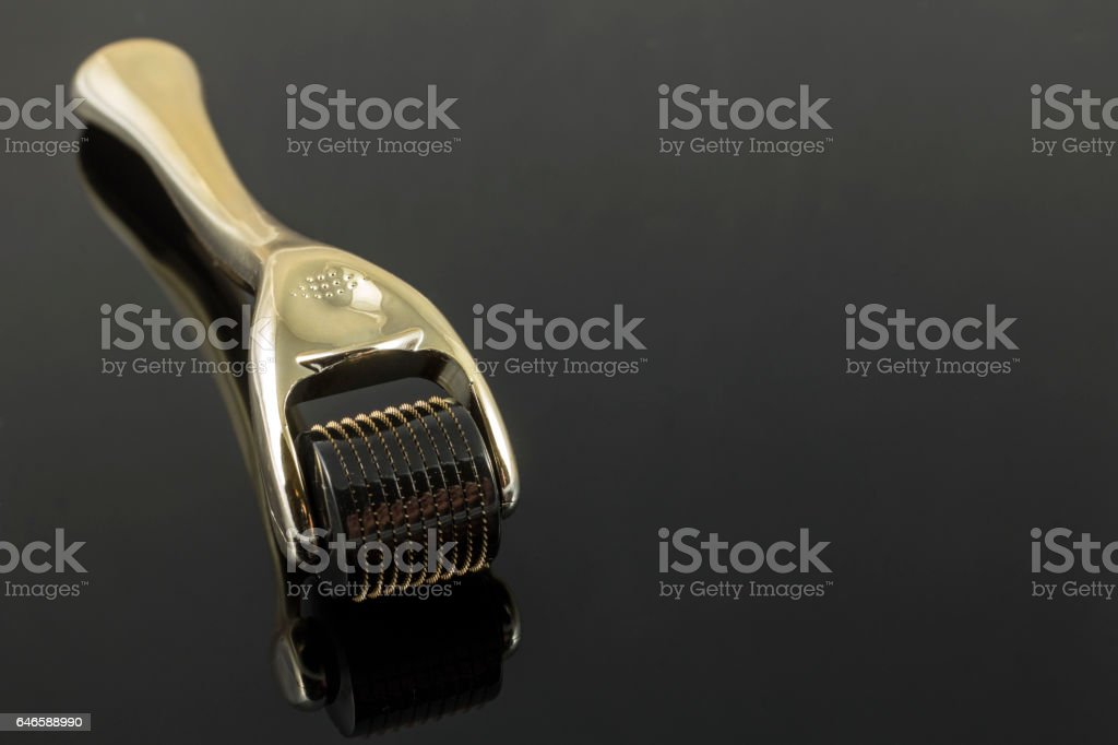 Derma roller for medical micro needling therapy. stock photo