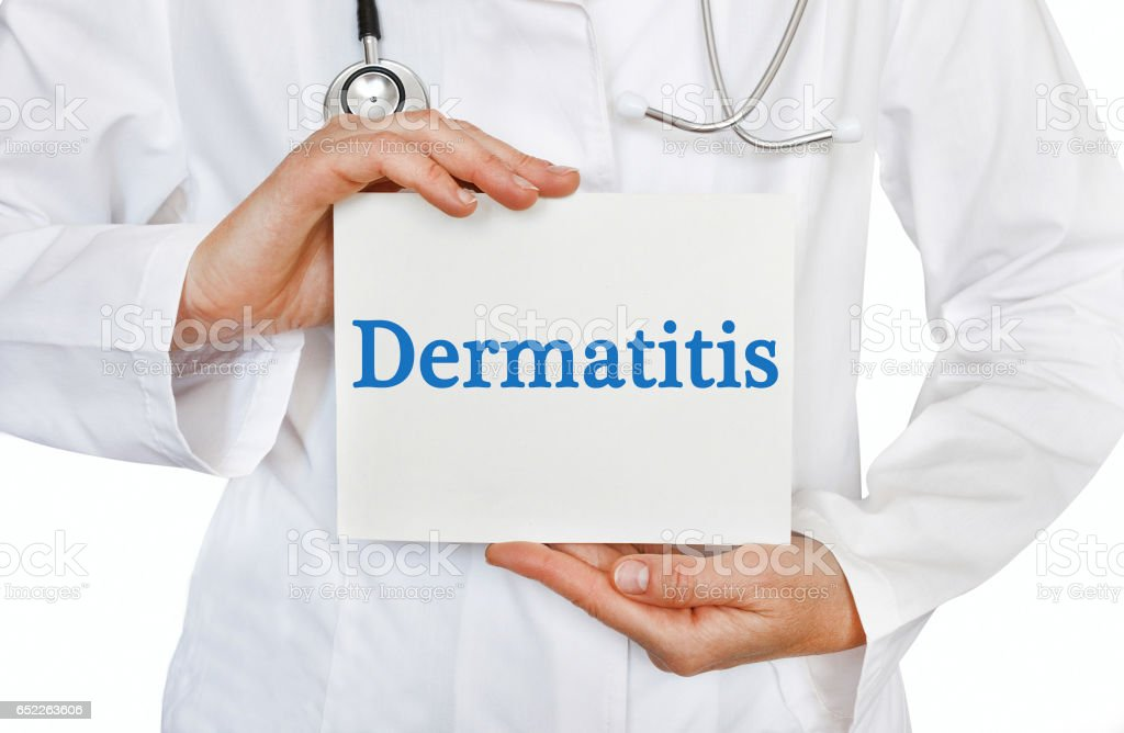 Dermatitis card in hands of Medical Doctor stock photo