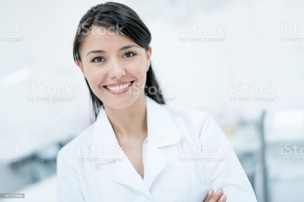 Dermatologist working at he practice stock photo