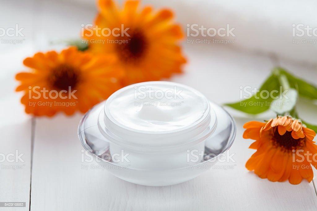 Dermatology herbal cosmetic cream with calendula vitamin spa lotion stock photo
