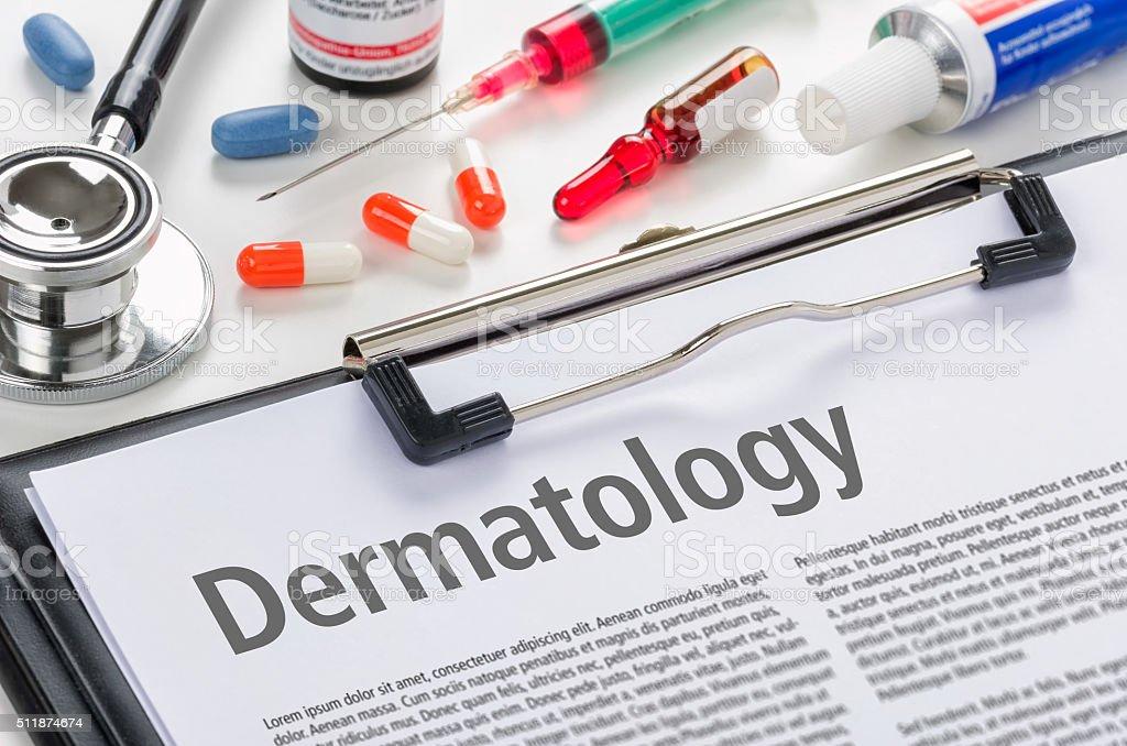 Dermatology written on a clipboard stock photo