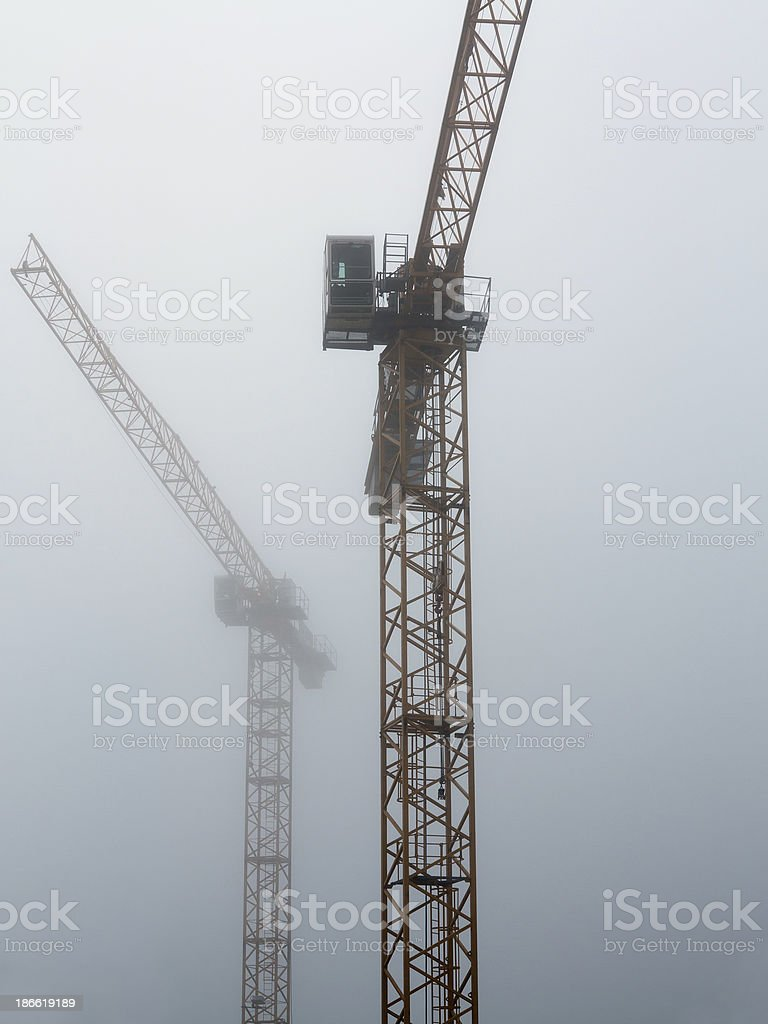 derricks in the fog royalty-free stock photo