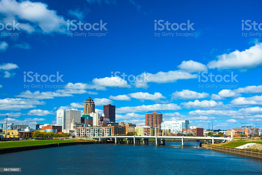 Des Moines skyline with puffy clouds and river stock photo