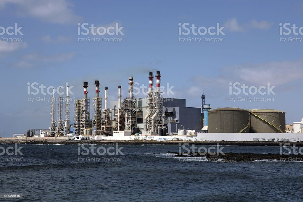Desalination plant on the ocean stock photo